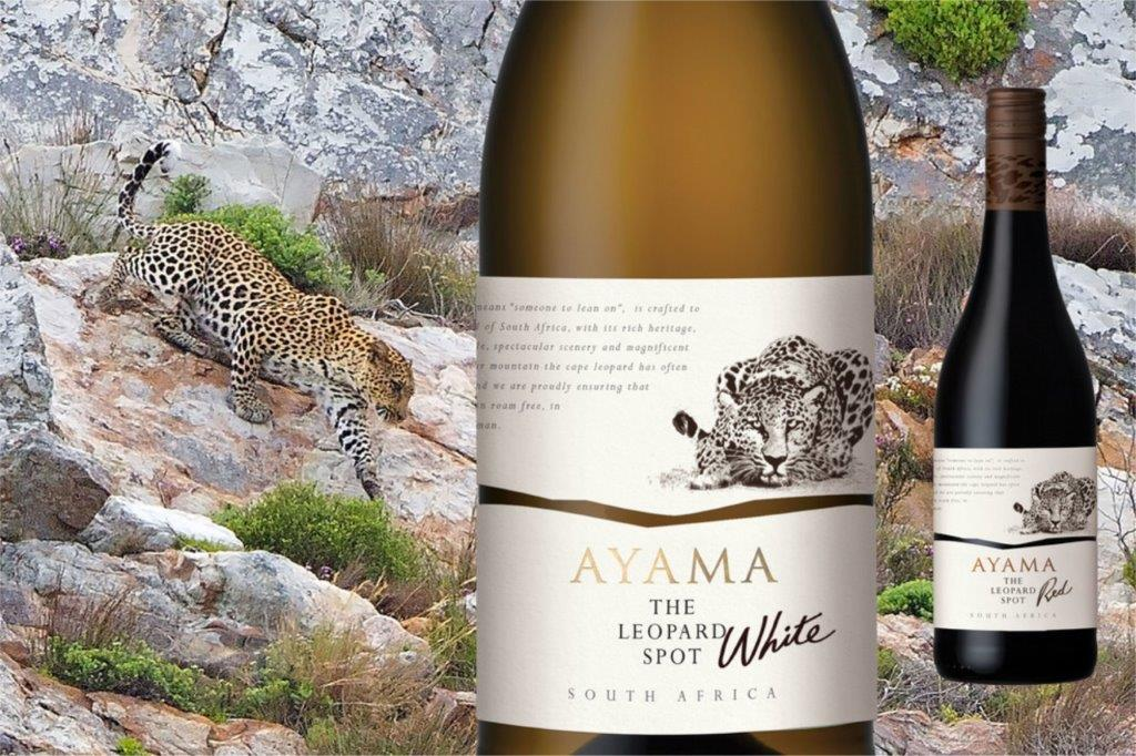 Leopard Logo On White Wine Bottle. Leopard Crawling Down Mountain Rock