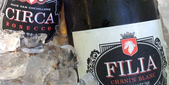 Bottles of Huis van Chevallerie. Filia's Chenin Blanc and Circa's Rosecco and on ice closeup.