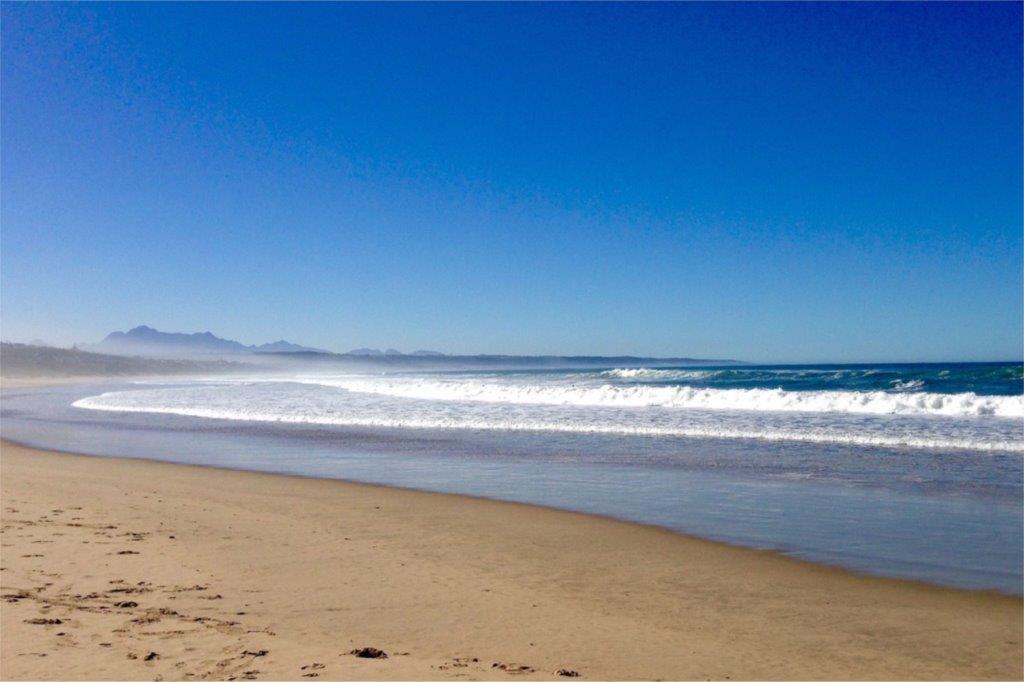 Salty sea spray summer sun beach Mountain in background
