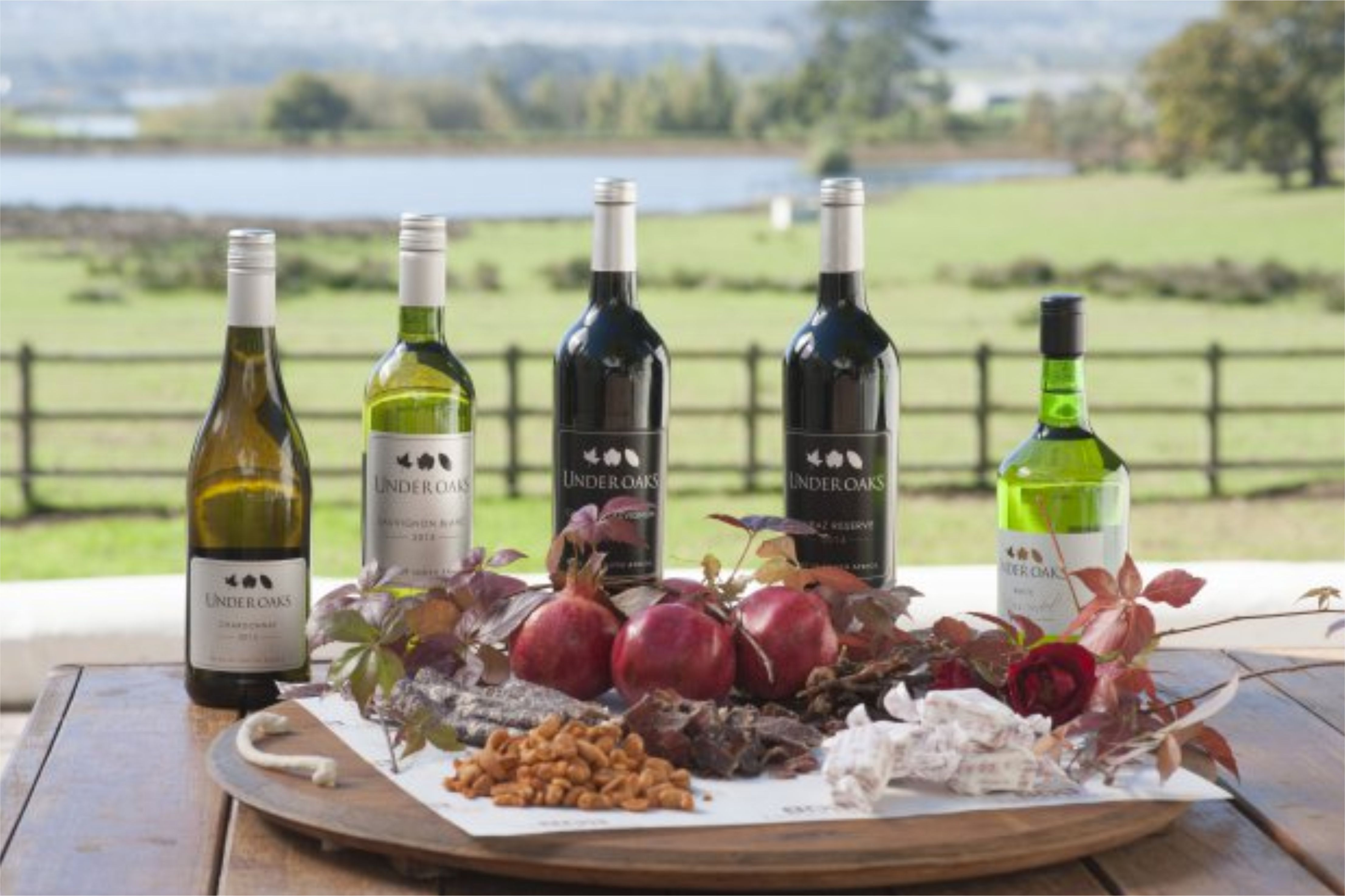 A selection of white and red wines from Under Oaks, with pomegranate fruit, biltong, boerewors, nougat and nut platter.